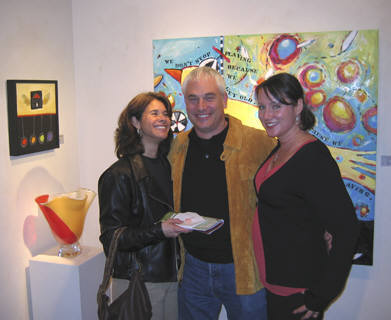 Artist: Gallery Event Photos, Title: Collectors, JoAnne and Doug pose happily with their new painting and Ms. Tomassi - click for larger image