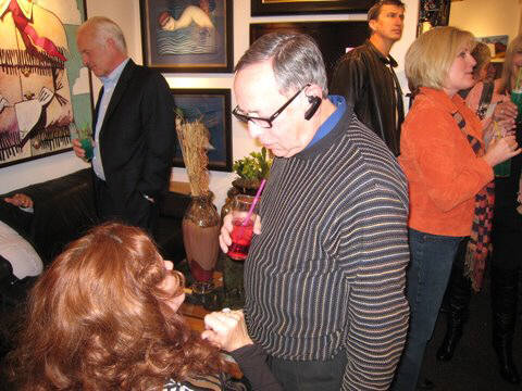 Artist: Gallery Event Photos, Title: Kenneth Behm trying to make nice with our lovely redhead - click for larger image