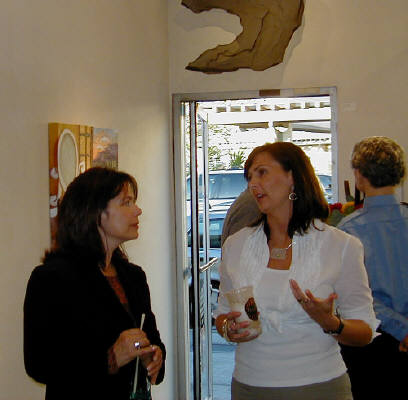 Artist: Gallery Event Photos, Title: Sept 2005-Collector Susanne Turnipseed discusses a commissioned painting with Holly Martz - click for larger image