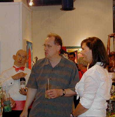 Artist: Gallery Event Photos, Title: Sept 2005- Collector Kenneth Wahlin discusses a painting with artist Holly Martz...Just buy it Kenneth! - click for larger image