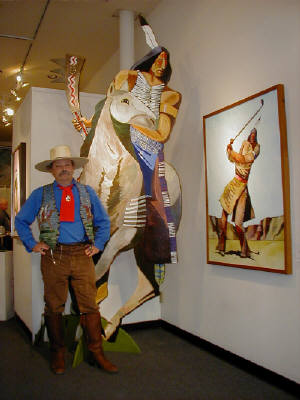 "Artist: Gallery Event Photos, Title: Thom Ross and one of his cut-outs for ""Custer's Last Stand"" - click for larger image"