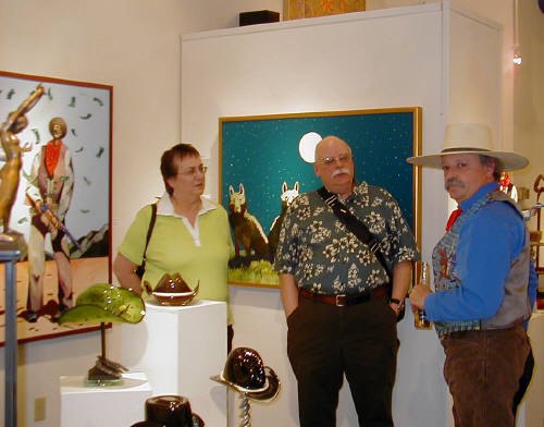 Artist: Gallery Event Photos, Title: Thom Ross talks with Collectors Mr. and Mrs. Young - click for larger image